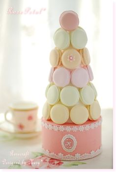 Macaron tower on top of cake - seriously, why didn't I learn to bake macarons before my wedding!