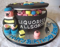 "you could use the liquorice cake recipe for a cake like this :-D ""The sweets on the board and on top of tin are made from sugar paste, but the ones inside are real ones..."""