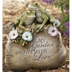 Joseph Studio 63171 Tall Garden Stone with 2 Frogs, Flowers Statue and a Verse My Garden Grows with Love, 9-Inch Joseph Studio,http://www.amazon.com/dp/B002IAWBD4/ref=cm_sw_r_pi_dp_XcjAsb16ARE5765R