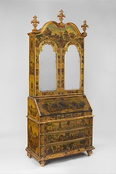 Desk (Secretary) Date:ca. 1730–35Culture:Italian (Venice)Medium:Pine; carved, painted, gilded, and varnished linden wood decorated with colored decoupage prints; mirror glass; the inside of the fall front lined wiht silk not original to the secretary