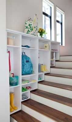 Autumn, here's an idea for your family room stairs. I'd turn the shelving so the were facing towards the glass doors. It would give you a place for the kids to store their crafts and such out of sight from the family sitting area but easily accessible for their use. That alcove could become the kids office space.