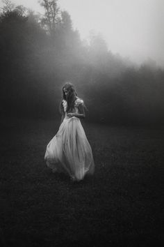 Liking the full body shot and the mysterious look of this photo. Again I enjoy the vibrancy of her white dress against the dark background.