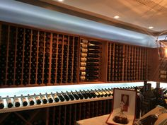 A cellar with a mixture of mahogany wine racks from WineRacks.com and VintageView metal racks