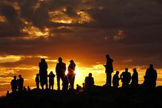 People are silhouetted on the top of a hill close to the border line between Turkey and Syria near Mursitpinar bordergate as they watch the U.S led airstrikes over ther Syrian town of Kobani on October 19, 2014. (Photo by Gokhan Sahin/Getty Images)