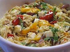 Orzo with roasted vegetables and a lovely lemon dressing and feta.