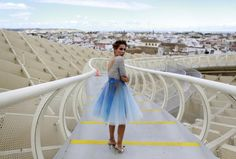 Spanish model, Angela Cristina, 27, stands on the footbridge of the wooden structure Metropol Parasol as she wears a creation by Francisco Tamaral during an urban photo shooting, part of the Andalucia de Moda (Andalusia Fashion) in Seville, southern Spain November 4, 2014.