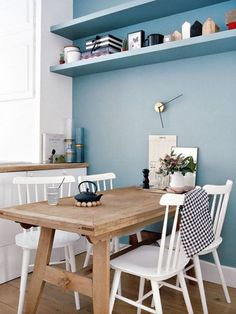 great idea to paint the shelves the same colour as the wall