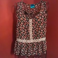 Adorable peplum style shirt Sheer shirt accented with pink and blue flowers... Tops Tank Tops