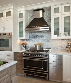 Provide landing areas next to major appliances. For safety and efficiency, consider placing a countertop landing area next to your major kit...