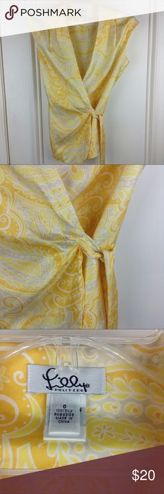 "Lilly Pulitzer Yellow Paisley Silk Wrap Shirt Lilly Pulitzer yellow paisley wrap shirt. 100% silk, sleeveless. Size 0. There is a small mark on the front left, it is hardly noticeable. 17"" chest, 25"" length. (PS27) Lilly Pulitzer Tops Blouses"