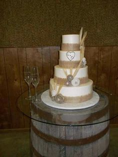 My wedding cake! Burlap ribbon with burlap flowers & wheat! ♥