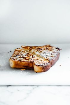 coconut almond brioche french toast with hibiscus poached rhubarb
