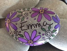 Hand-painted, one-of-a-kind Happy Rock - Emma. This beautiful one-of-a-kind river rock was found on the coast of Maine. Not that you need a use for a Happy Rock, but there are many! Incorporate them into your home decor, garden, potted plants; they make great paper weights; some are useful in meditation; and of course they make great gifts. And Happy Rocks are smile provoking... you cant help but smile when you look at them! :-) This Happy Rock measures approximately 2 x 3. All rocks are…