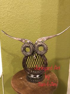 Junkyard Art by Tam-I-Am. Repurposed horseshoe, gears, and pliers come together as a Steampunked owl. Scrap metal art.