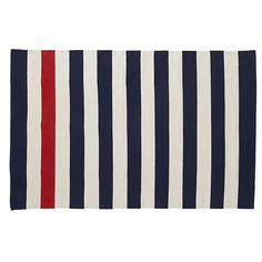 Ocean Liner Rug: With bold, modern navy stripes, it features a single red stripe for an unexpected pop of color.