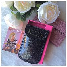 Betsey Johnson PDA/Phone Case Shimmering black glitter design, this Betsey Johnson Case may be used to hold your phone and fits an iPhone 6. Could also be utilized to conveniently carry cash, a credit card and your favorite lipstick! A perfect accessory for those times you want a compact storage solution. Brand new, comes with pink glitter box. Would make a fabulous gift! From a pet/smoke free home. Betsey Johnson Accessories Phone Cases