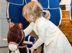Yesterday Princess Estelle got a rocking horse and a sward by the lifeguard #princessestelle #crownprincessvictoria #rockinghorse #sward #bernadotte