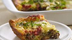"""Pillsbury:  Sausage-Pomodoro Brunch Bake. """"Start with crescents. Pile on the sausage, tomatoes, two cheeses and eggs. Bake and voila! You've got brunch."""""""