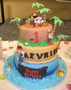 Jake and the Neverland Pirates - Cake is covered in MMF. Characters are made from MMF. Treasure chest is carved rice krispie treats.