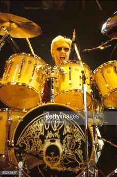 Photo of QUEEN and Roger TAYLOR, Drummer with Queen performing on stage at th Freddie Mercury Tribute concert