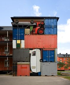 """The installation """"Self Contained"""" by Michael Johansson resembles an oversized Tetris game. The artist has shipping containers, trailers, cars, tractors, etc., stacked one above the other, so that at the end of an almost perfect rectangle with dimensions of 8.2 x 10.8 x 2.4 m has been released.    http://www.ignant.de/2010/06/29/self-contained-von-michael-johansson/"""