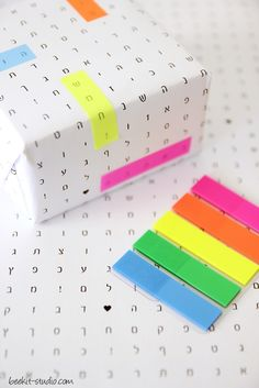 Alphabets, letters, words, highlighting - we love crosswords so we're mighty big fans of this gift wrapping idea!