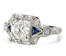 This website has a large collection of antique style engagement rings and other jewelry that is very unique in design. Everyone knows how much I LOVE unique rings, as mine is very different! This site has lots of affordable (and some not-so-affordable) unique rings for those who are looking for something a little different for their ladies! :)