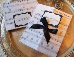 Chic Musique. Wedding Invitations with Antique Sheet Music, Set of 40. $130.00, via Etsy.