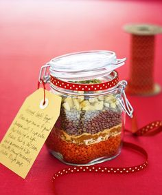 Dried lentils and seasonings are layered into a beribboned Mason jar to create this inexpensive, one-of-a-kind holiday gift. Get the recipe for Curried Lentil Soup  - GoodHousekeeping.com