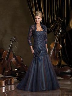 Sophisticated Mother of the Bride Dress. A taffeta gown with a lace illusion neckline by Ivonne D.