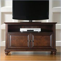 "Crosley Furniture Cambridge 42"" TV Stand in Vintage Mahogany Finish - Constructed of solid hardwood and wood veneers, this cabinet is designed for longevity. The rich, hand rubbed, multi-step Vintage Mahogany finish is perfect for blending with the family of furniture that is already part of your home. Antique Brass finish hardware adds a touch of style to this already beautiful cabinet."