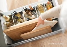 Bottles and cutting boards stored together in a drawer with ORGA-LINE inner dividers. More ideas for clever storage organisation in your kitchen on www.blum.com/ideas