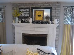 Gorgeous spring mantel - love the pops of yellow!