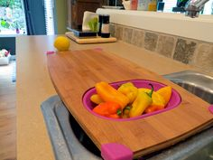 over the sink bamboo cutting board in use