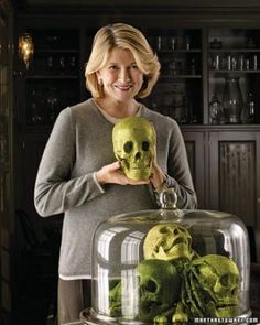 34 Martha Stewart Halloween Table Ideas. Love this one, a cake stand full of the unexpected...green skulls, LOL! Martha calls them Glittered Skeletal Parts.