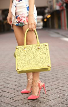 How to style a Bright Color Handbag - I absolutely love color and I am so excited that all the handbags I see this season are rainbow colored. I think its most fun to pair these bright colors with even more color. Instead of clashing the colors are complimentary