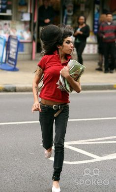 """Amy Winehouse leaves her house and runs to the local newsagents to collect some newspapers and a copy of the classified adverts paper """"Loot"""". Too busy to cook, Amy also grabs a nutritious snack of a chocolate bar and a bag of crisps."""
