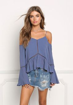 cold shoulder blouse with trumpet sleeve and ladder trim