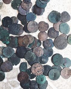 Found out that one of my neighbors is a real treasure hunter! He found these coins at the bottom of the ocean. Been diving all his life. Has a massive collection...just incredible! This was the beginning of what he has.  Would you wear jewelry with coins from centuries ago? Any coin collectors out there?