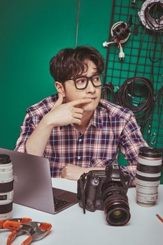 2PM's Chansung rocks the pro photographer look for a new set of '6 Nights' concert posters! | allkpop.com