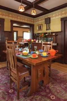 The dining room is centered on a reproduction Stickley keyhole trestle table set with vintage Fiesta dinnerware. Ceiling beams were uncovered when a false ceiling was removed. A Turkish carpet anchors the room. Vintage Industrial Decor, Industrial Dining, Vintage Home Decor, Vintage Interiors, Vintage Ideas, Craftsman Dining Room, Craftsman Interior, Craftsman Style, Craftsman Decor