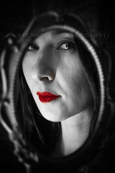 Reflection of woman in round mirror. Photo copyright Christie Goodwin, all rights reserved