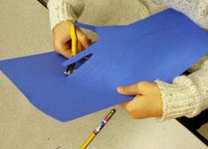 2nd grade students filled their background with positive/nice words. Then by rubbing the side of different crayons, students gave their co...