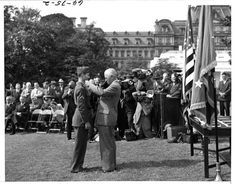 President Harry S. Truman (right) awards the Congressional Medal of Honor to Corporal Desmond Doss (left),the first Conscientious Objector to receive a Medal of Honor, on the White House lawn, October 12, 1945.