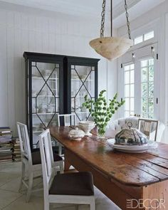 love the farm table and more modern chairs!