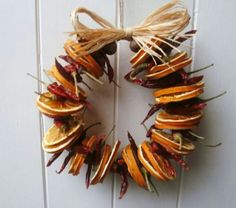 noel 2019 Rustic dried chilli & orange slice wreath this wreath consists of dried orange slices & dried chillies finished with a jute string hanger and raffia bow beautiful bright colours to compliment your country kitchen All Things Christmas, Christmas Holidays, Christmas Wreaths, Natural Christmas, Homemade Christmas, Christmas Projects, Holiday Crafts, Yule Crafts, Yule Decorations