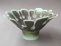 Ceramics by Richard Baxter at Studiopottery.co.uk - Porcelain plant form dk green bowl 12cmH 23cmD, 2007.
