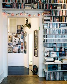 I've always thought of doing an entire wall in shelves, floor to ceiling ... and now that I see it, I like how it looks.  Except I would make mine built-ins with adjustable shelves within it.