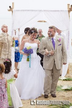 Newlyweds Walking Aisle While Being Showered With Bubbles After Beach Wedding