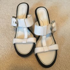 Liz Claiborne summer white sandals buckle detail These are stunning sandals all done in white with black detail and side buckle. Wedge Heel. The perfect summer sandal. Size 9 1/2 M Liz Claiborne Shoes Sandals